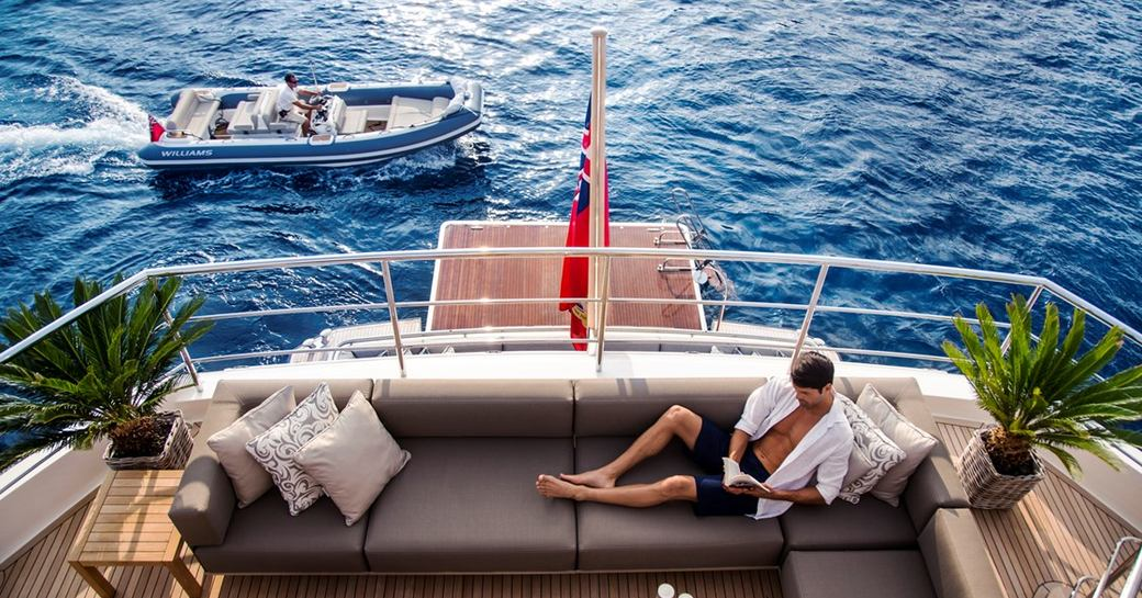Man relaxing on luxury charter yacht