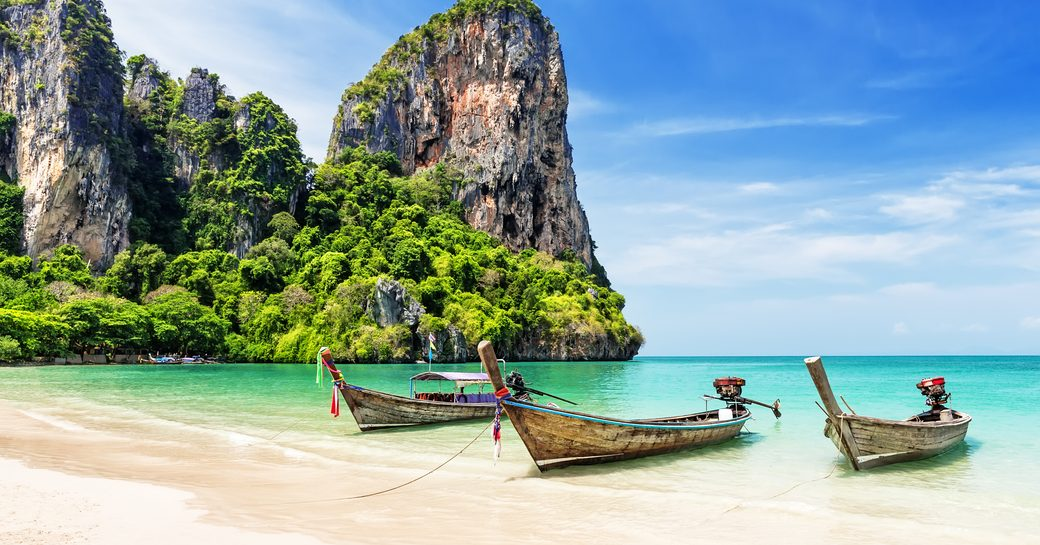 Boats at shore in Thailand