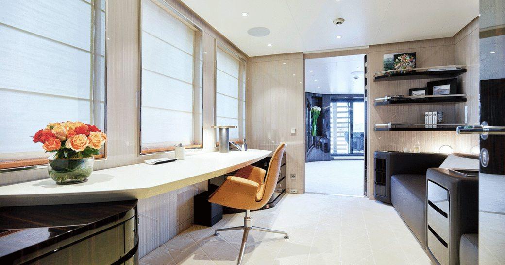 office on board luxury yacht soaring adjoined to main salon