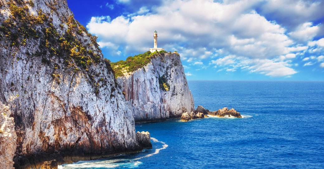 lighthouse on the cliff of Cape Lefkatas in Greece