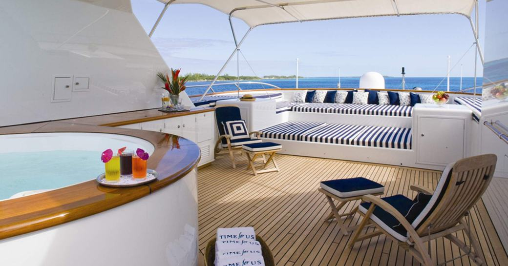 Luxury yacht sundeck on M/Y BROADWATER with jacuzzi pool and sun loungers
