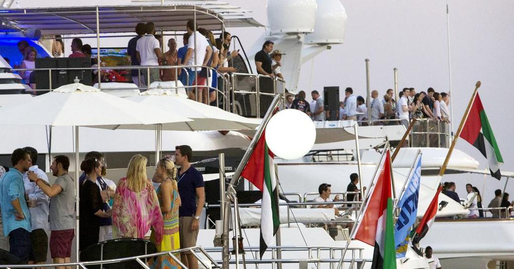People partying on superyachts lined up at Yas Marina, Abu Dhabi