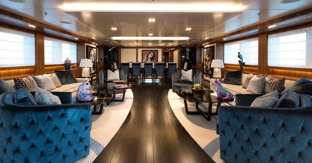 Large elegant, wood floored lounge on superyacht RARITY