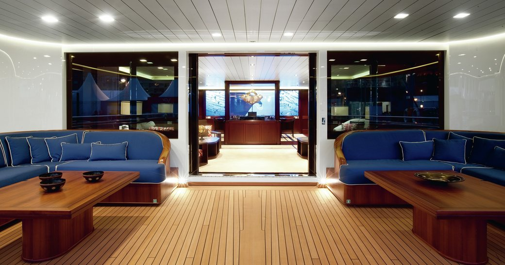 main salon and outdoor seating area of luxury yacht galileo g