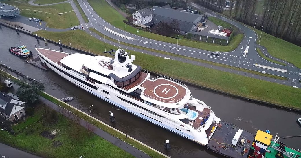 Megayacht Lady S aerial image as she passes through bridge on canal in Holland