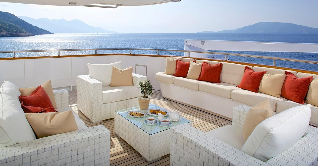 seating area on superyacht idylle, sofa seating with lovely cushions and glass coffee table