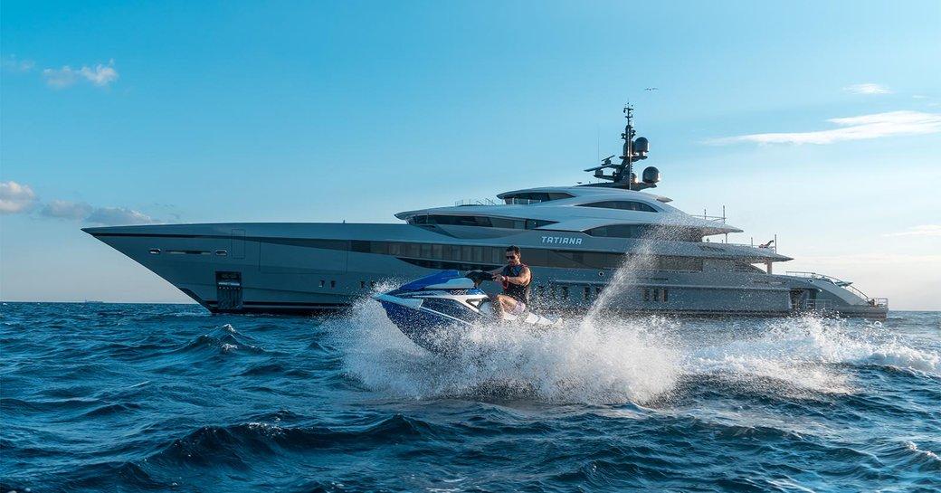 luxury yacht tatiana with jet ski alongside