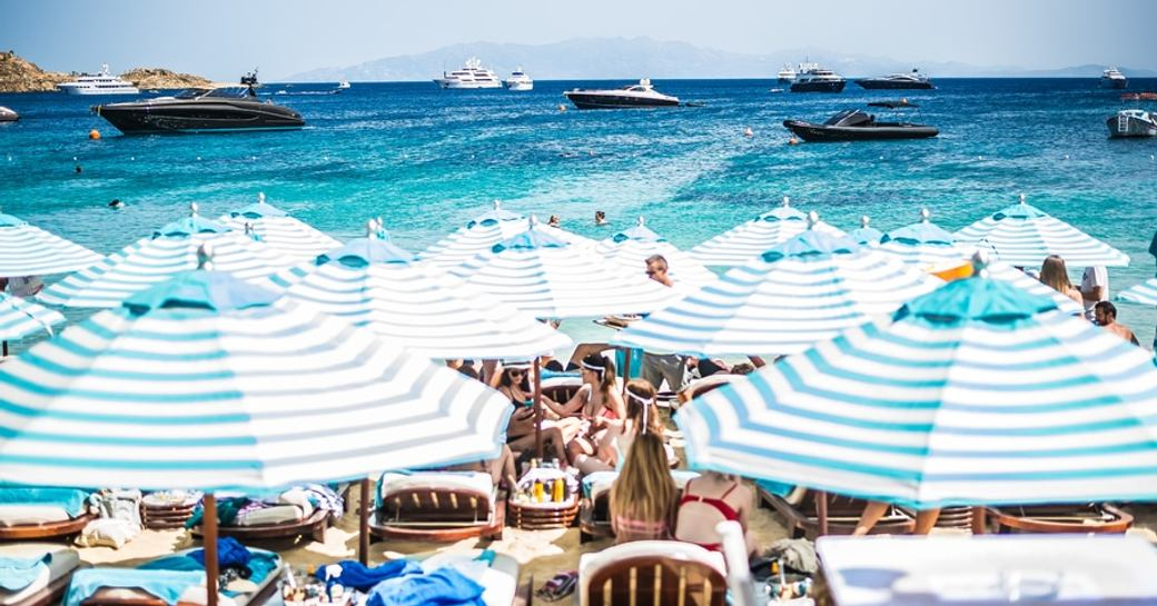 Superyachts and sunbathers gathered at Nammos Beach Club