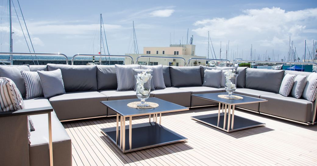 U-shaped sofa on the upper deck aft of luxury yacht 'Princess AVK'
