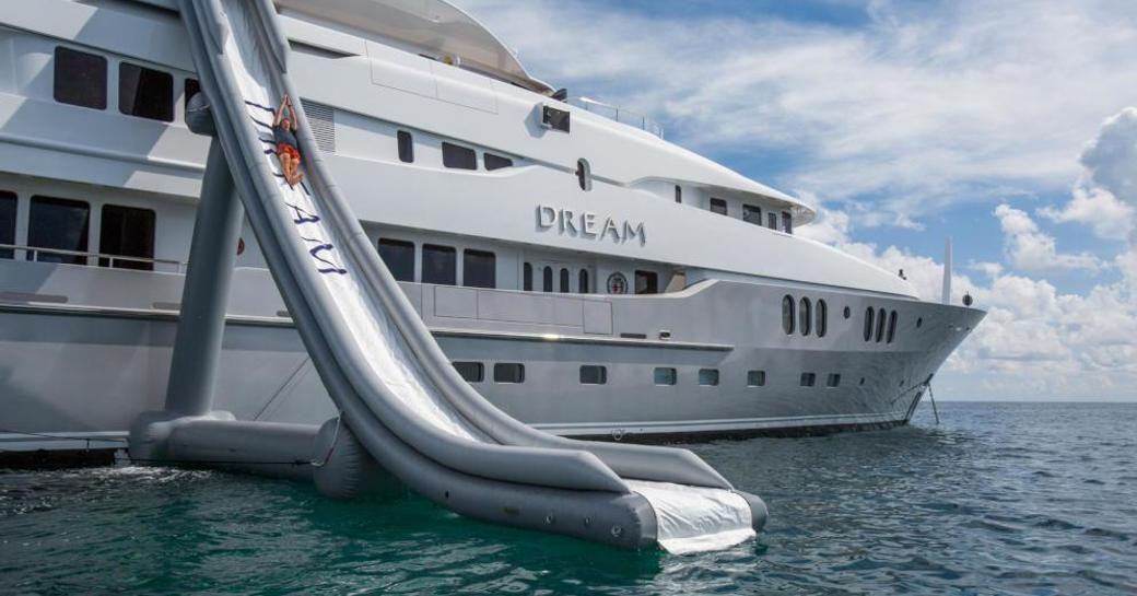 Superyacht DREAM with an inflatable slide attached to the sundeck