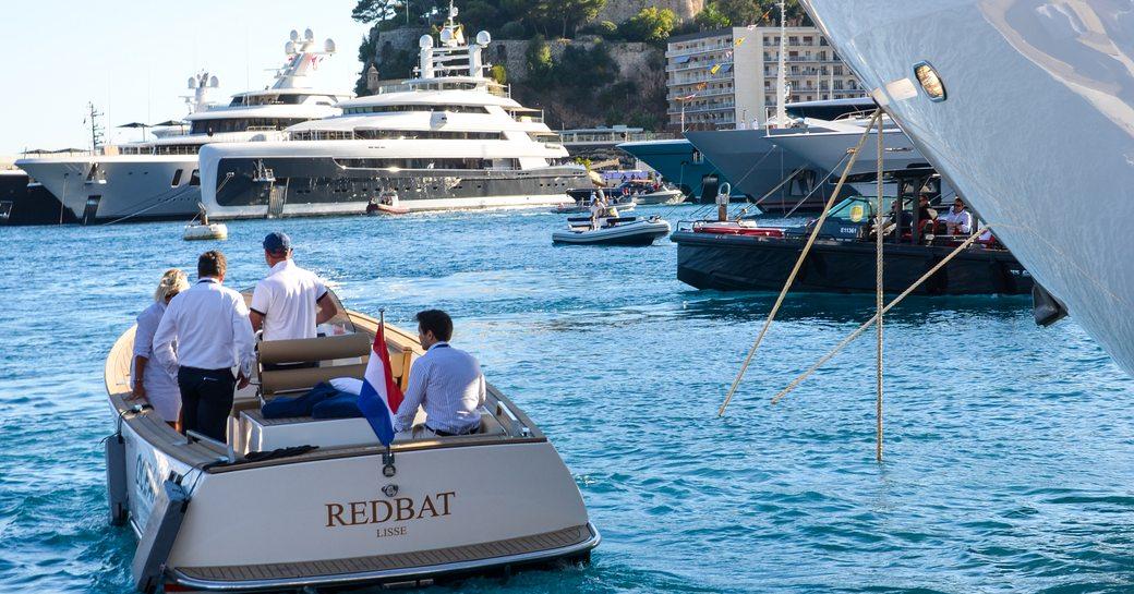 tender floats alongside superyacht at monaco yacht show