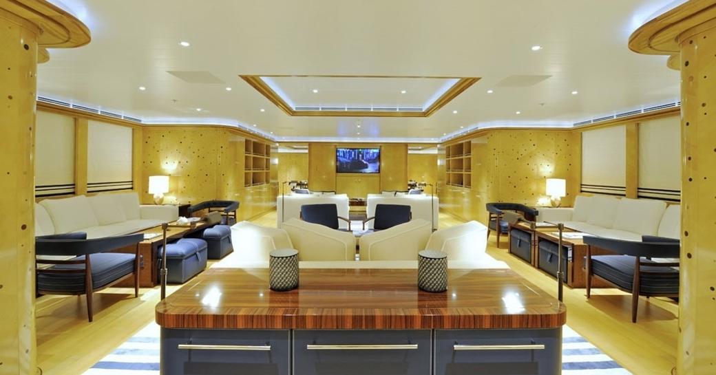polka dotted maple walls in main salon aboard motor yacht TV