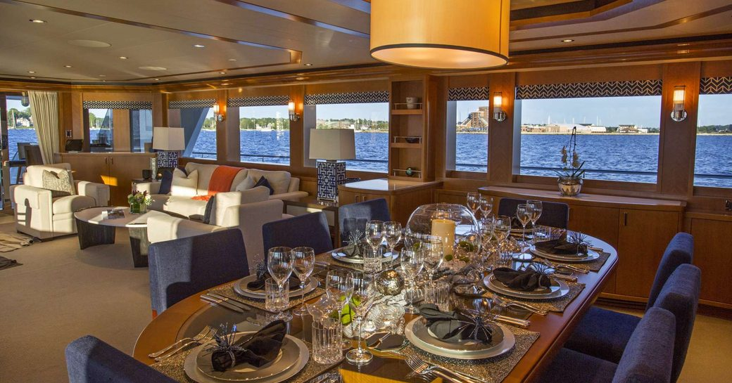 Main salon on luxury yacht Far Niente, with large windows and formal dining
