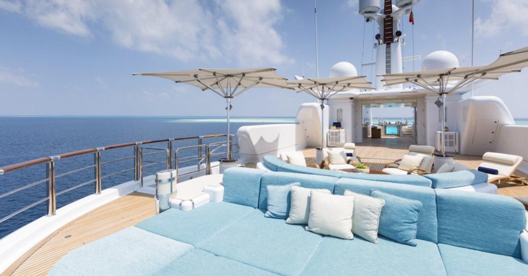 Spacious sun pads onboard luxury yacht charter NIRVANA.