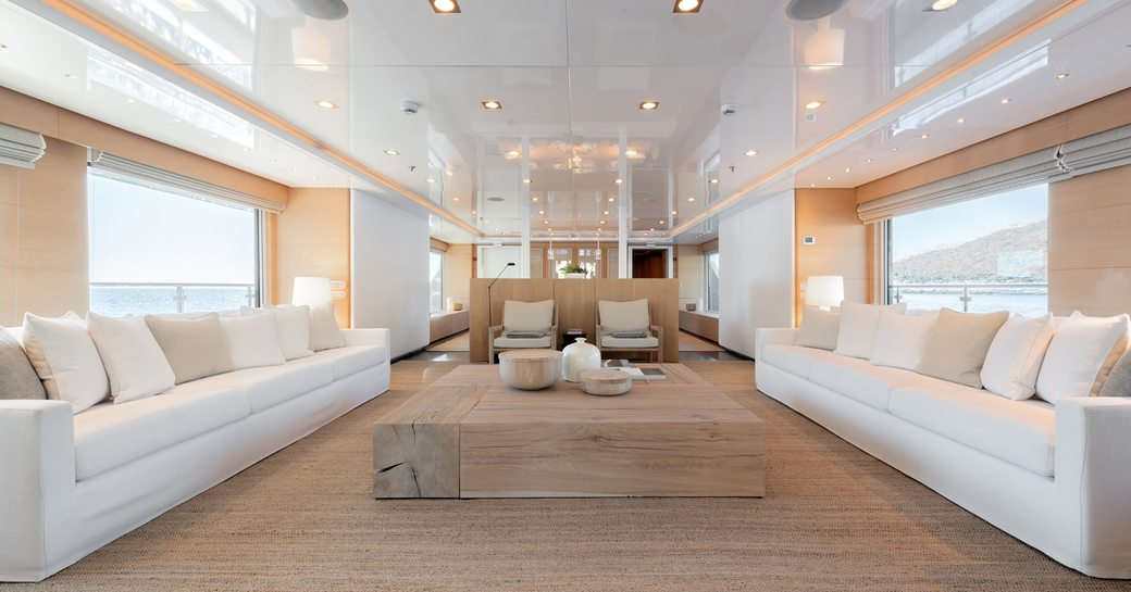 Elegant white interior of ARBEMA - plush white sofas and light colored floor with lots of natural light