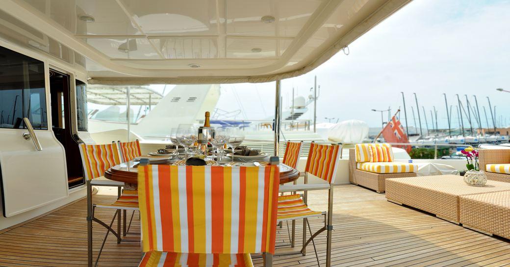 Aft deck alfresco dining set-up on deck of superyacht
