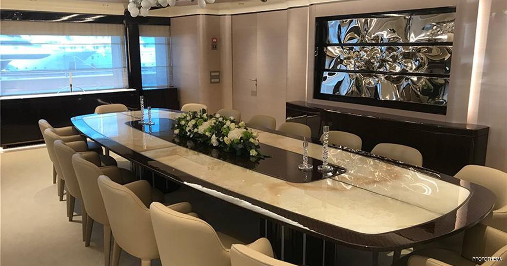dining salon on opari superyacht with chandelier