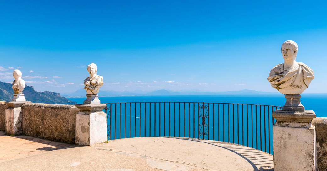 Marble busts line Belvedere of the Villa Cimbrone overlooking Amalfi coast