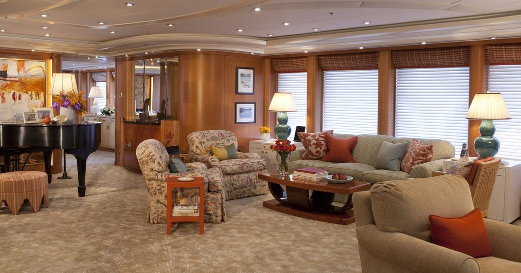 warm and welcoming main salon aboard superyacht OASIS with grand piano