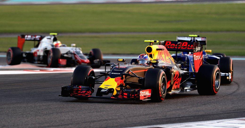 Two cars rounding a corner of the Yas Marina Racing Circuit in Abu Dhabi, UAE