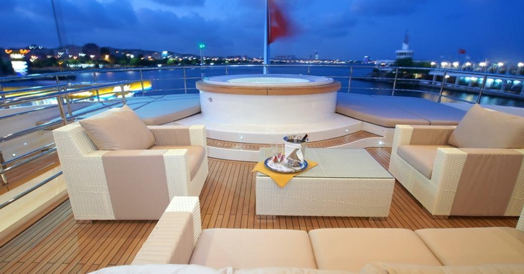superyacht TATIANA's deck jacuzzi and sofa's