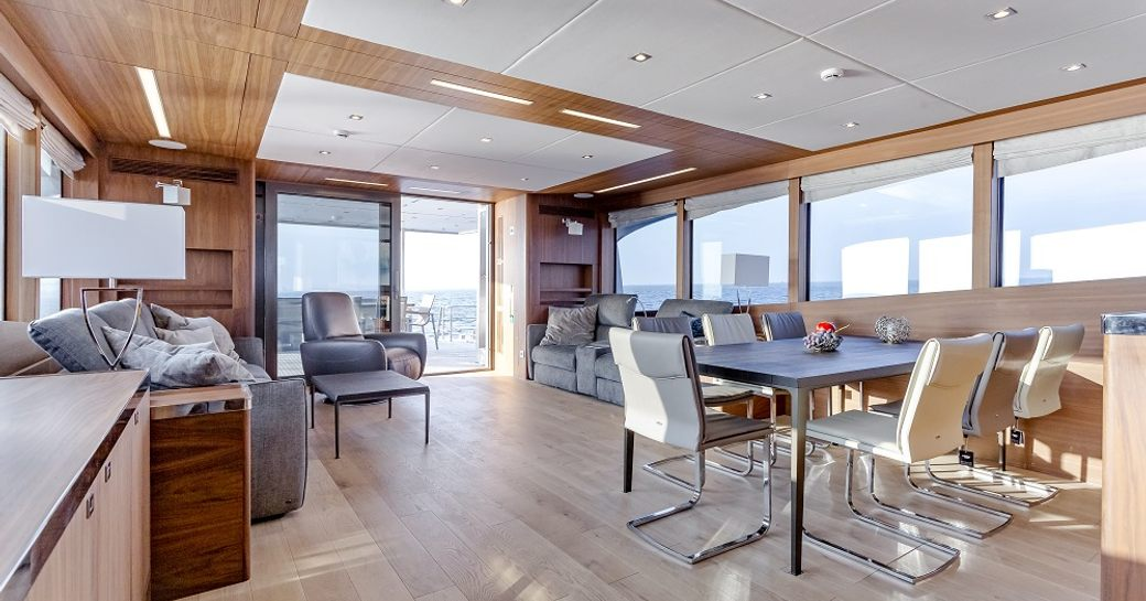 dining table and lounge area aft in the main salon of superyacht Timeless
