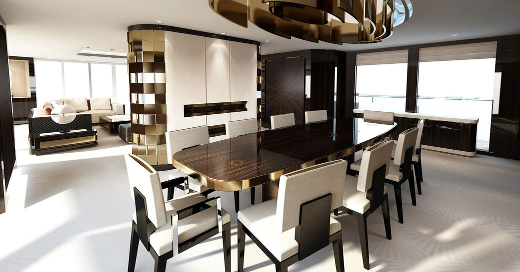 main salon of charter yacht soaring, with dining and gold light fixture