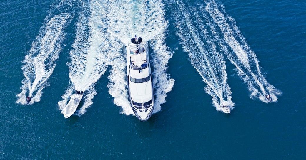 Motor yacht TEMPTATION cruising with tender