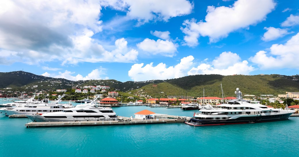 Overview of Yacht Haven Grande in St Thomas US Virgin Islands, superyachts moored at berths with Charlotte Amalie in background
