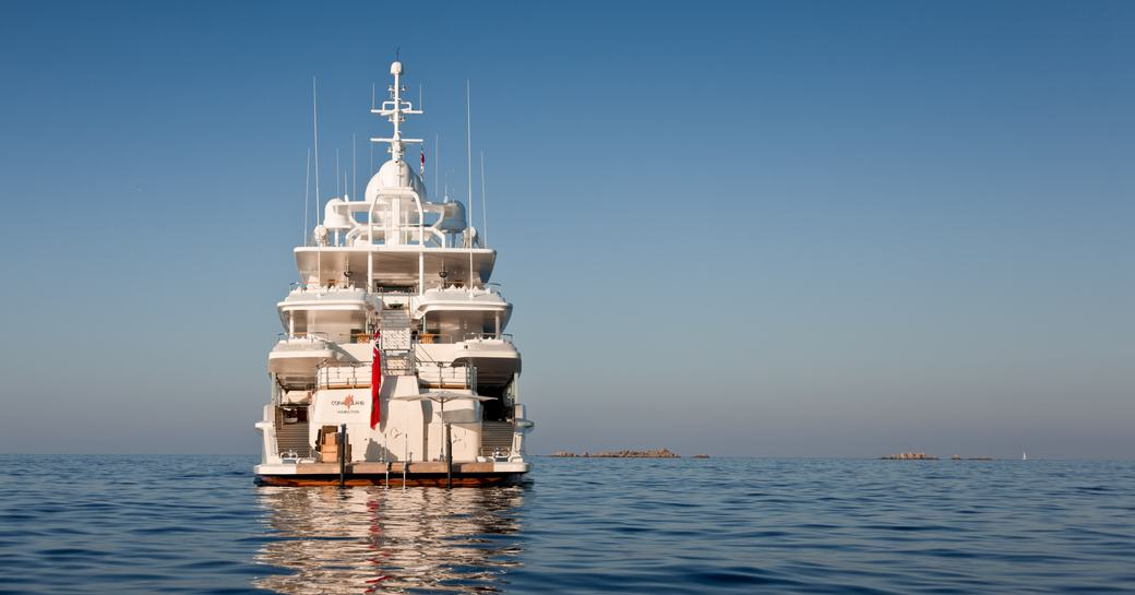 An aft view of superyacht 'Coral Ocean' sat on the water