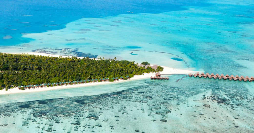 The Maldives aerial picture of beaches, blue sea and lush greenery
