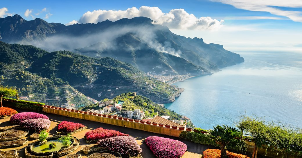 flowery gardens of ravello with mountains in background