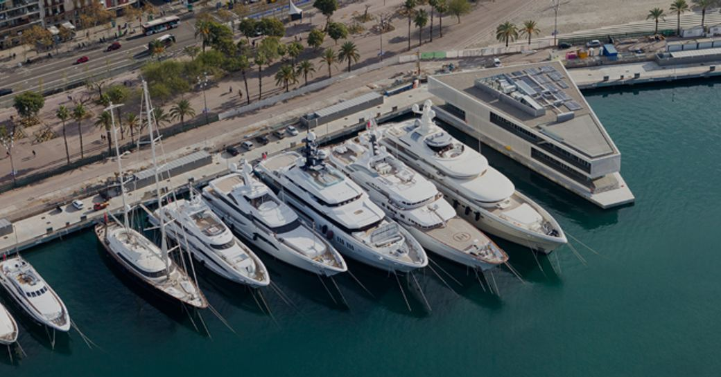Superyachts lined up in OneOcean Port Vell, Barcelona