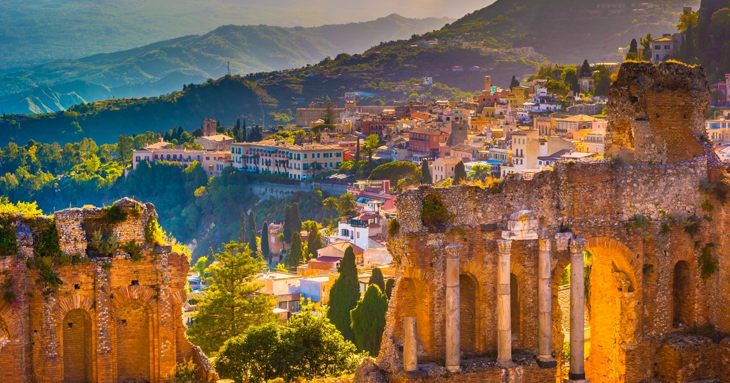 the Ruins of Taormina Theater Sicily a famous attraction in Sicily and also a popular attraction with guests on a luxury yacht charter vacation