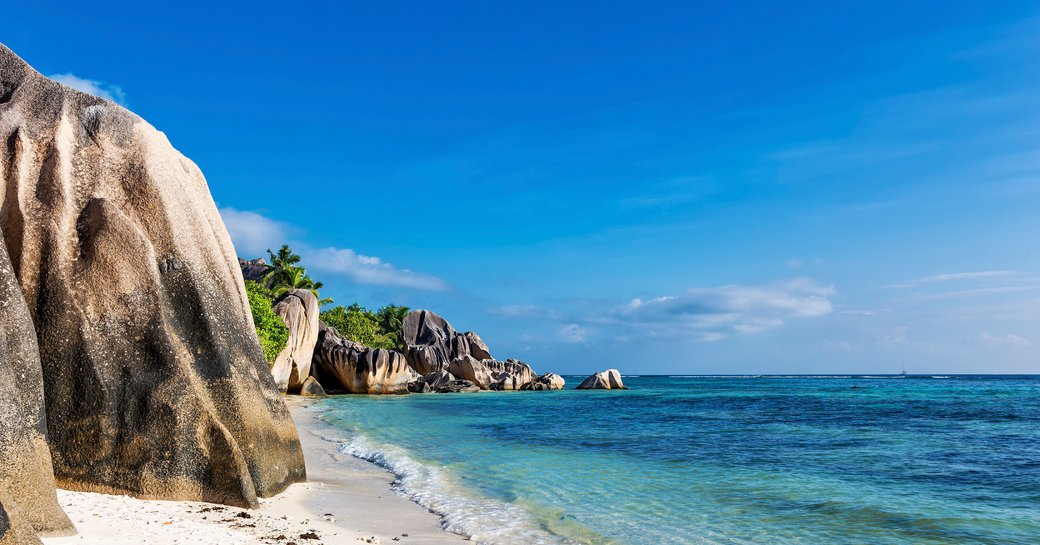beach in the indian ocean, white sand beaches and large rocks