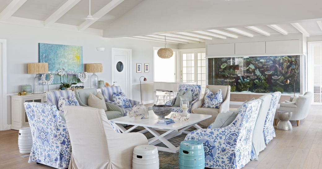 family room on thanda island, with lounge seating and aquarium