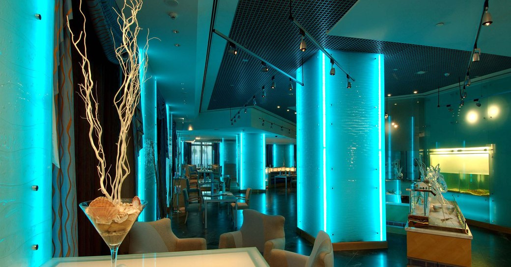 modish lighting diffuses through aquariums to give restaurant Sayad an ethereal blue glow