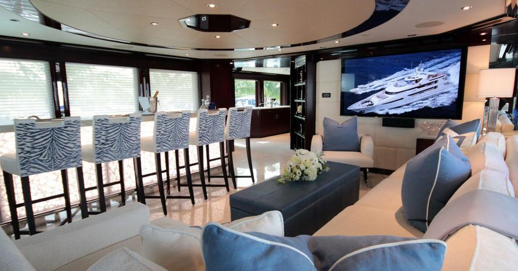 stools line the granite-topped bar with a sofa nearby on board superyacht TRENDING