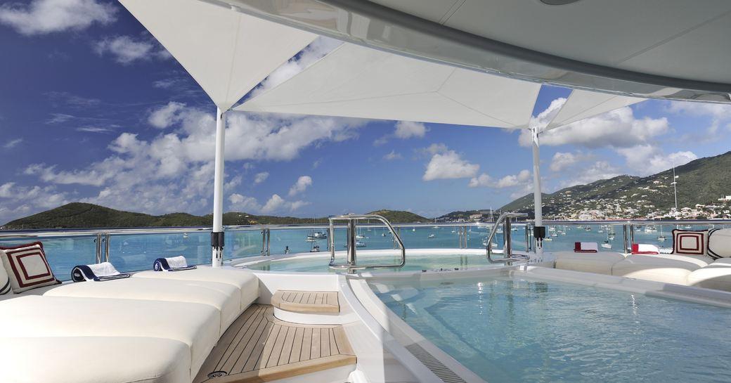 TV's on deck swimming pool