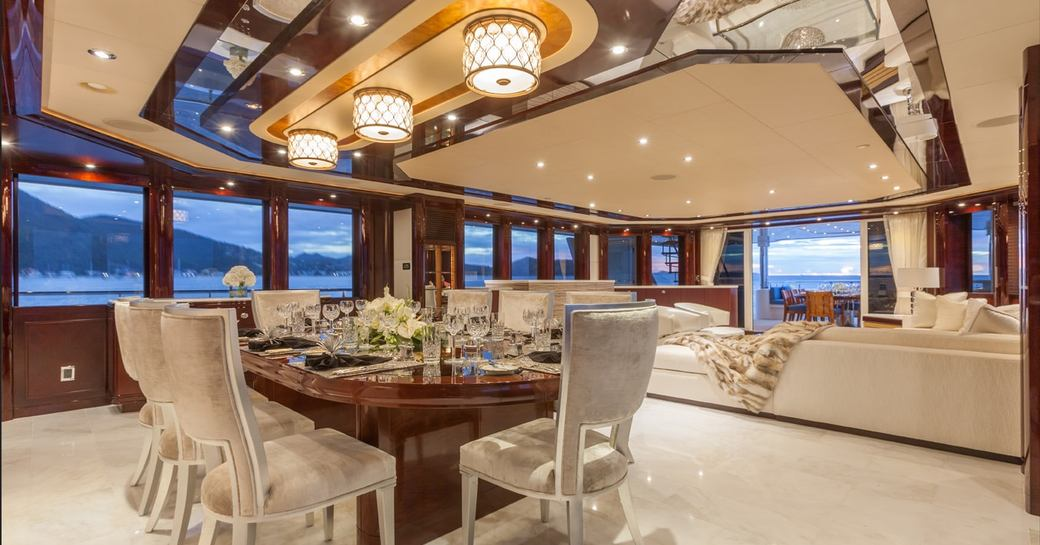 Formal interior dining on board luxury charter yacht