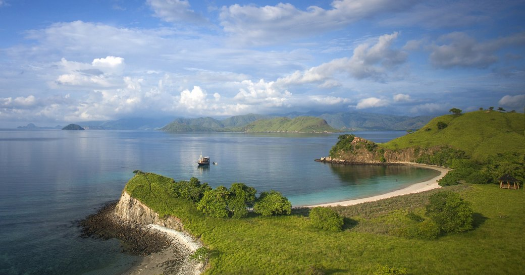 the idyllic Pink Beach lapped in blue waters in Komodo