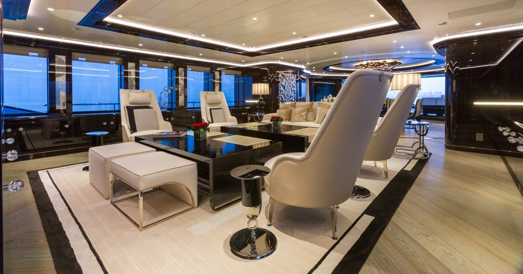 dark woods and pale upholstery in main salon aboard superyacht OKTO