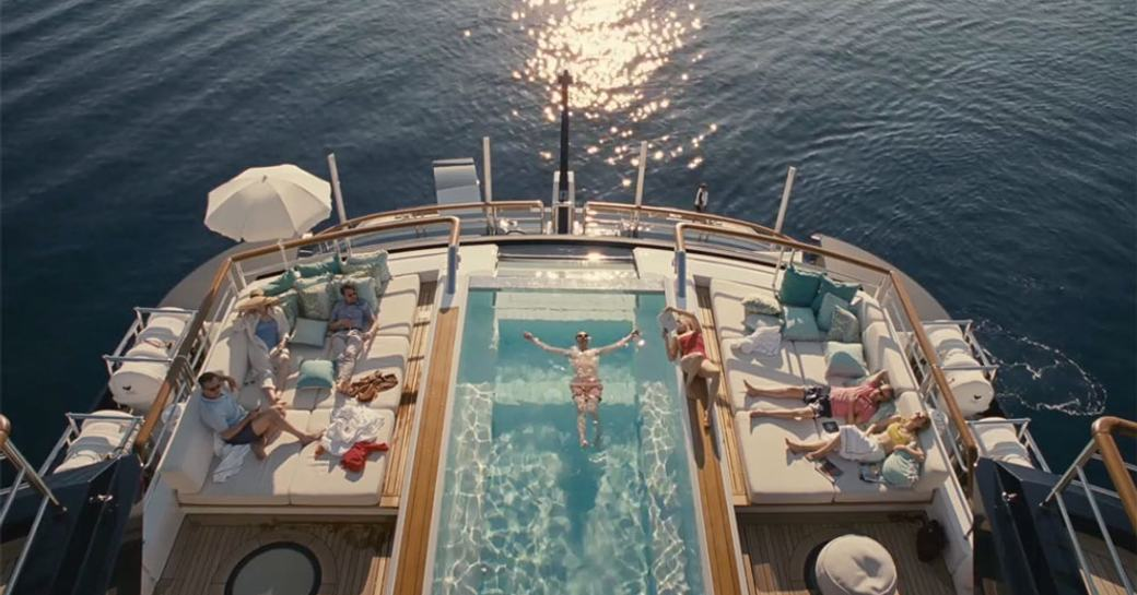 Roy family sit on the aft decks of superyacht SOLANDGE