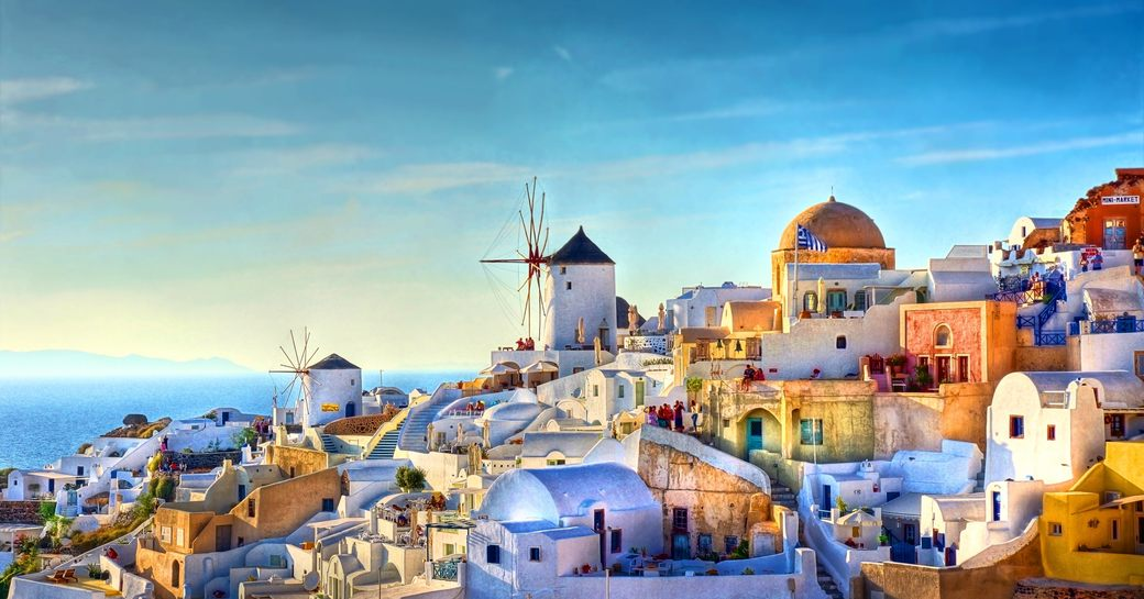 a lively cosmopolitan city in the Mediterranean at dawn