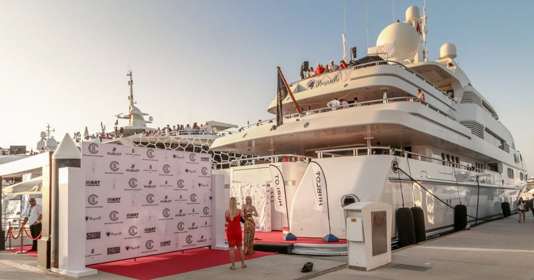 party-goers on board a large tri-deck superyacht berthed in Yas Marina to watch the Abu Dhabi Grand Prix