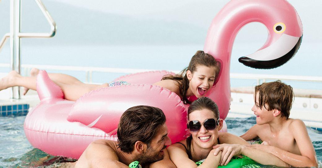 fun in the pool onboard family yacht rental