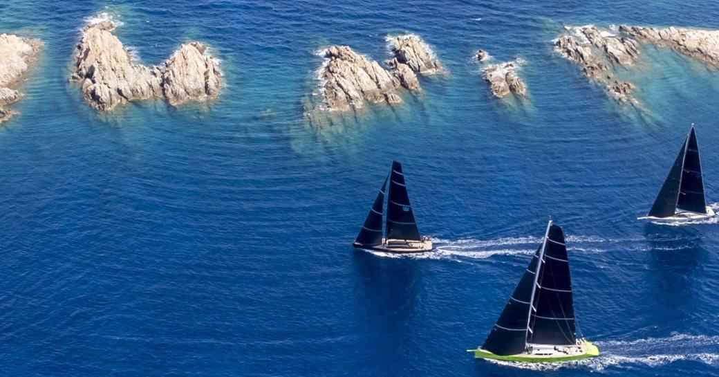 Aerial view of sailing yachts on the water at Loro Piana Superyacht Regatta