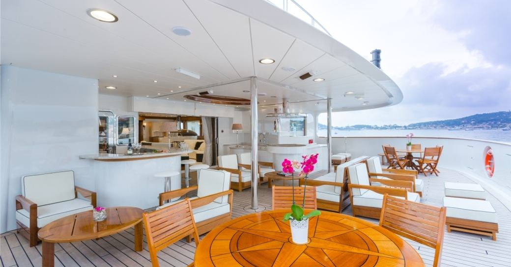 chairs, tables and bar on the upper deck aft of expedition yacht LEGEND