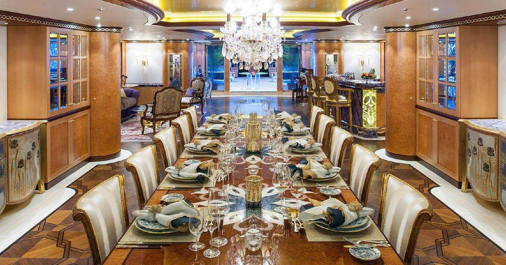 glittering dining room on board charter yacht SOLANDGE