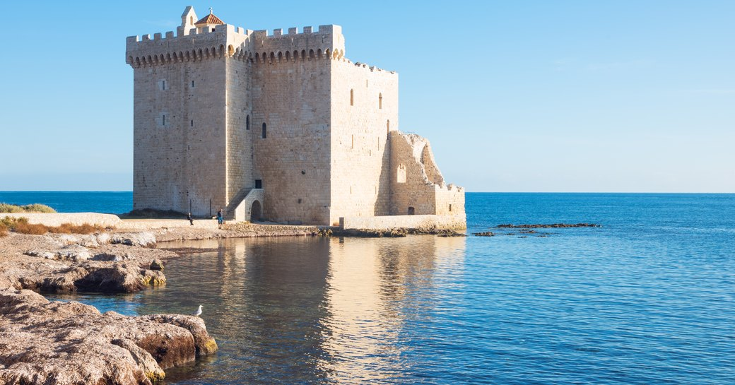 Well-preserved fortified ruins of a medieval monastery by the sea on the island of Saint Honorat